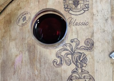 Provence Wine Tours - Glass of red on a cask