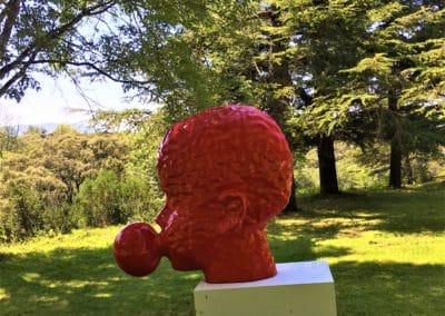 Provence Wine Tours - Château Vignelaure, a contemporary sculpture of a red head.