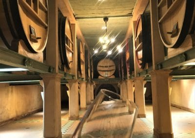 Provence Wine Tours - At Bandol, a glass of red wine in the cellar of a winery